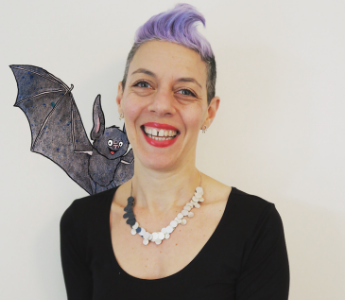 A portrait of Nicki Greenberg, a woman with light peach song and purple hair. She is posing with an animated bat on her shoulder