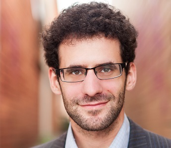 A portrait of Eli Glasman