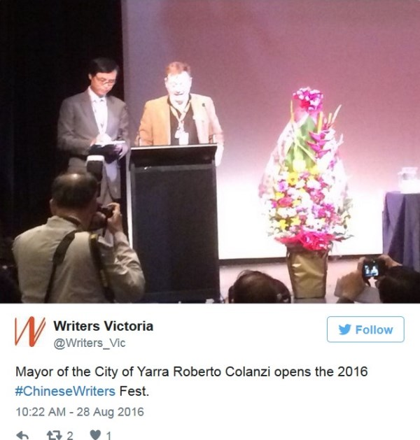 Photo of two men standing at a lecturn. Twitter feed from Writers Victoria says: Mayor of City of Yarra Roberto Colanzi opens the 2016 Chinese Writers Fest